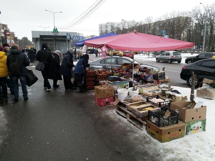 People on street in city during rainy season