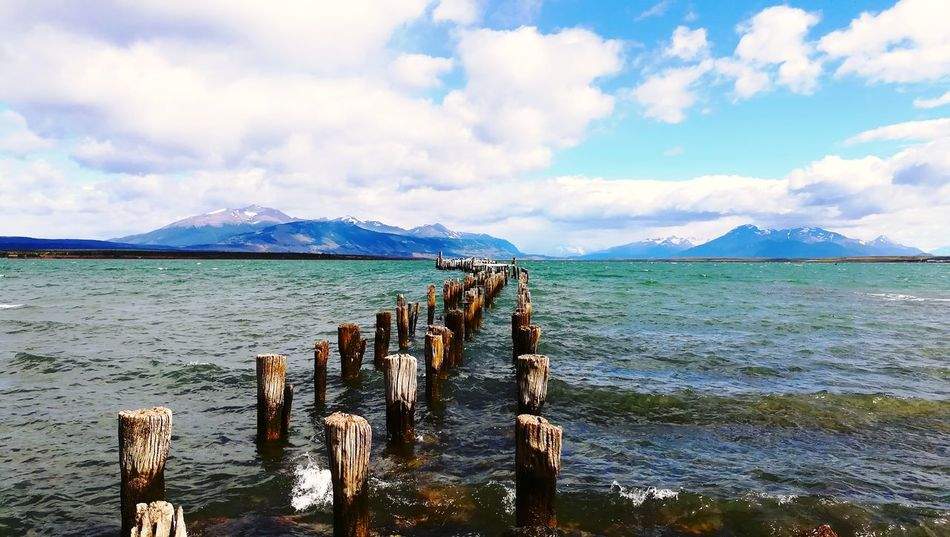 Muelle Histórico, Costanera. Surdechile! Magallanes  Mountain Puerto Natales Cloud - Sky Sea Sky Mountain Water Scenics Day Nature Tranquility No People Beauty In Nature Mountain Range