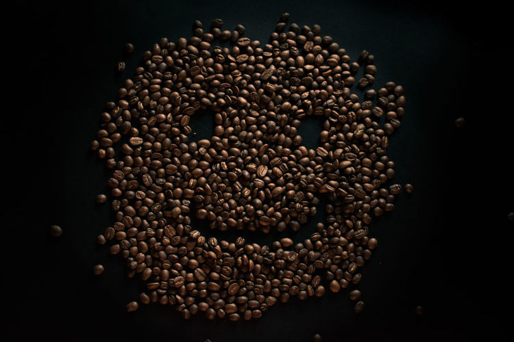 High angle view of coffee beans against black background