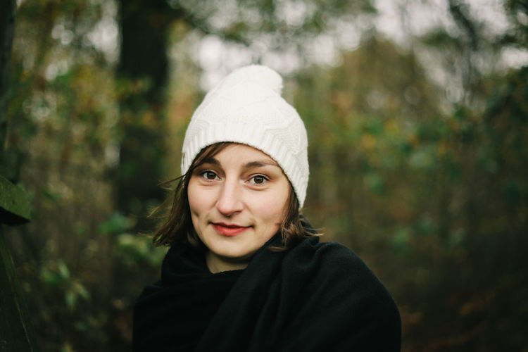 Capture The Moment Casual Clothing Child Childhood Day Emotion Focus On Foreground Forest Front View Headshot Innocence Land Looking At Camera Nature One Person Outdoors Plant Portrait Smiling Tree White Cap White Winter Cap Winter Cap Women