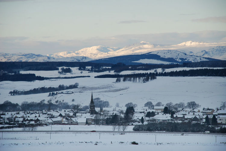 Scottish Village Beauty In Nature Cold Temperature Day Landscape Mountain Mountain Range Nature No People Outdoors Scenery Scenics Sky Snow Sun On Mountain Tranquil Scene Tranquility View Into Land Village View Water Winter