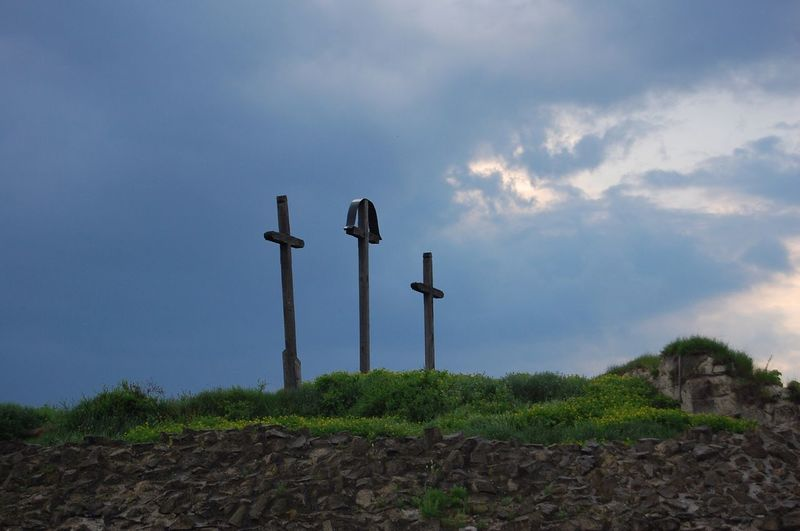 Low angle view of crosses on field