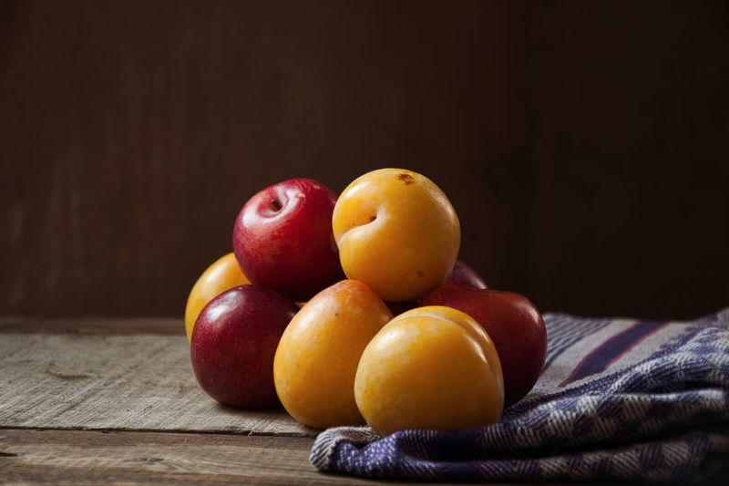 Plums on wooden