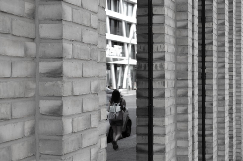 Architecture Berlin Berlin Love Brick Wall Reflection Woman Adult Architecture Berlinstagram Blackandwhite Building Building Exterior Building Story Buildings Built Structure City Day Detail Full Length Lifestyles One Person Real People Walking Window Women