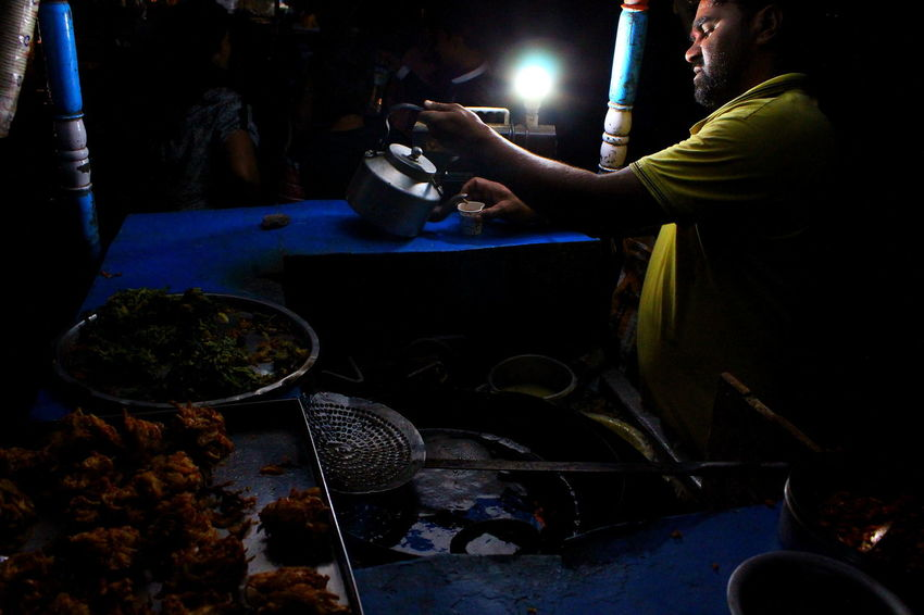 Food Food And Drink Human Hand Night One Person People Preparation  Real People Street Photography Street Food Vendors Tea Time Tea Cup Pakoda