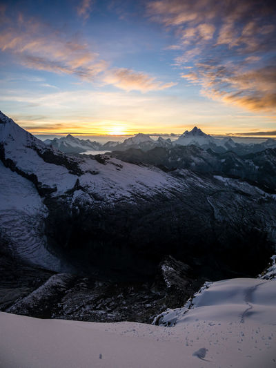 Beauty In Nature Sky Scenics - Nature Sunset Winter Cold Temperature Tranquility Tranquil Scene Cloud - Sky Mountain Snow Non-urban Scene Idyllic Nature Landscape Environment Mountain Range No People Water Snowcapped Mountain Mountain Peak
