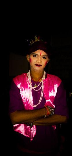 Portrait of beautiful young woman in darkroom