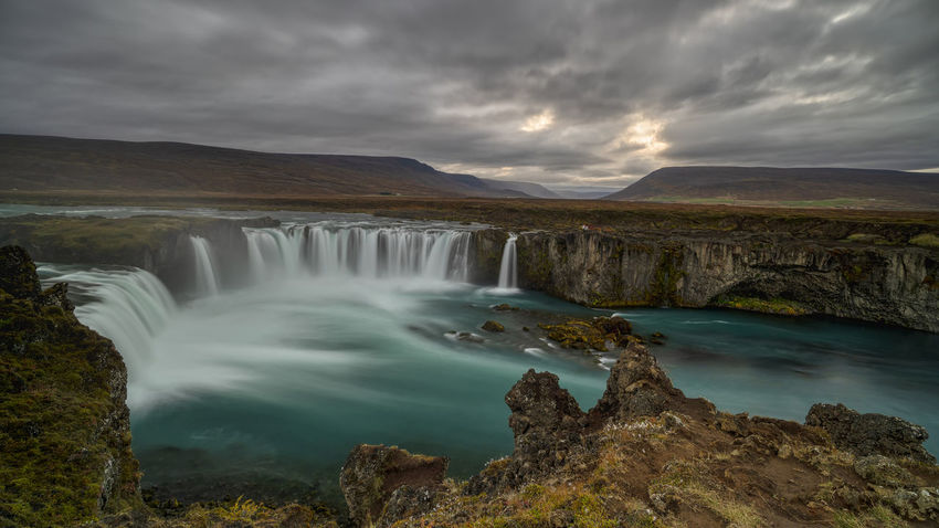 The Goðafoss is a waterfall in Iceland. It is located in the Bárðardalur district of Northeastern Region at the beginning of the Sprengisandur highland road. The water of the river Skjálfandafljót falls from a height of 12 meters over a width of 30 meters. Scenics - Nature Water Beauty In Nature Waterfall Motion Long Exposure Nature Flowing Water No People Outdoors Power In Nature Flowing Goðafoss Waterfall Sunrise Sunset Environment Blurred Motion Majestic Beauty In Nature Horseshoe Falls Rocks Cloud - Sky Sky Mountain Non-urban Scene Tranquil Scene Rock Rock - Object Idyllic