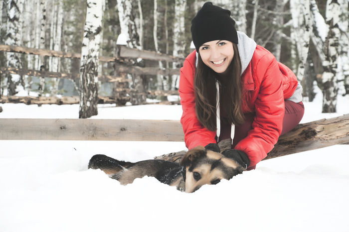 Winter Time Snow Day Young Women Cheerful People Outdoors One Person Beauty Close-up Beautiful Woman Young Adult Looking At Camera Portrait Front View Woman And Dog