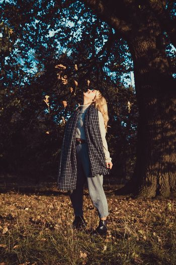 Autumn leaves One Person Tree Full Length Forest Standing Real People Young Women Leaf Nature Young Adult Outdoors Day Autumn Lifestyles Women One Young Woman Only Adult People First Eyeem Photo Perspectives On Nature