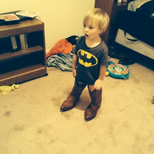 His reaction was like oh no she didn't!!!! Babyinboots Cowboyboots Batman Cute Awwwwww Priceless Forevermylove