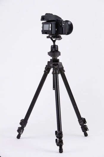studio shot of high end digital camera on the tripod Camera Photography Multimedia Expertise Professional Occupation Tripod Photograph DSLR Lens Equipment Photographic Theme Photographing Black Nobody White Background Medium Format Camera Photography Themes Technology Studio Shot Camera - Photographic Equipment Indoors  No People Still Life Photographic Equipment Close-up Digital Camera Copy Space Single Object High End Medium Format Activity Cut Out Arts Culture And Entertainment