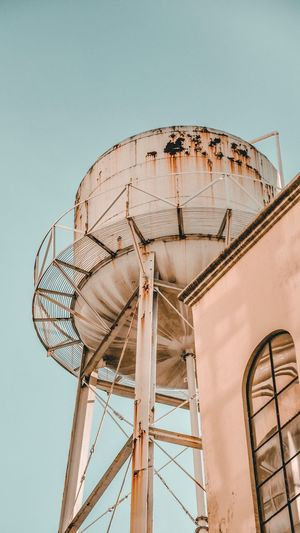 Low angle view of water tower against clear sky