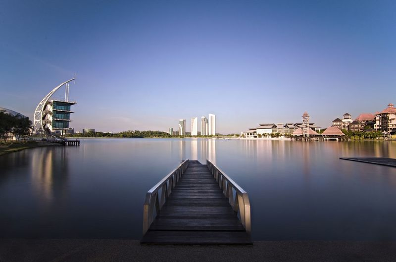 ASIA Architecture Blue Building Exterior Built Structure City Clear Sky Day Lake Landscape Malaysia Nature No People Outdoors Putrajaya Reflection Sky Symmetry Travel Destinations Water