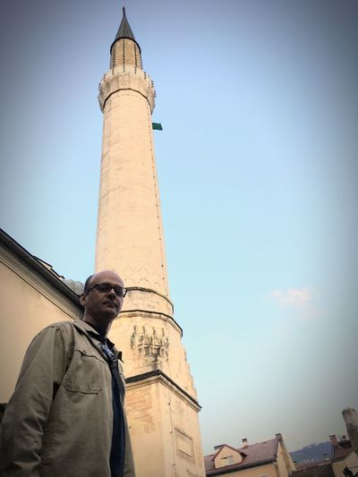 Middle aged tourist in front of the minaret of Gazi Husrev-beg Mosque at the centre of Sarajevo Gazi Herzegovina Religion Religious  Spire  Landmark Suburban Destination Culture Minaret Muslim Oriental Sarajevo Middle Aged Tourist Tower Day History Building Real People Travel Destinations Men Travel Tourism City Tall - High