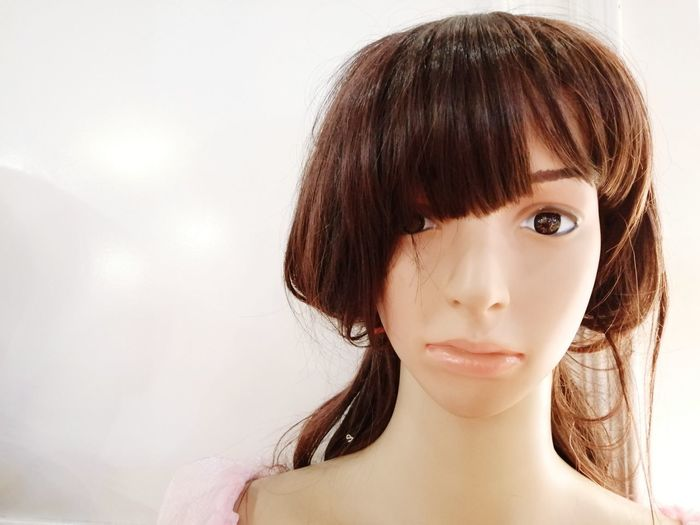 Close-up of mannequin against white background