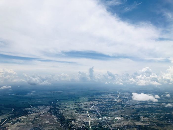 Beautiful clouds, sea and settlements views seen from the plane. Cloud - Sky Sky Scenics - Nature Environment Beauty In Nature Aerial View Day Architecture Building Exterior City Tranquil Scene Landscape No People Nature Tranquility Built Structure Outdoors Cityscape