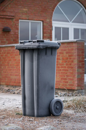 a garbage for a house at a frosty morning Architecture Brick Wall Building Exterior Built Structure Day Environmental Issues Frosty Mornings Garbage Garbage Bin Garbage Can No People Objects Outdoors Wastepaper Basket
