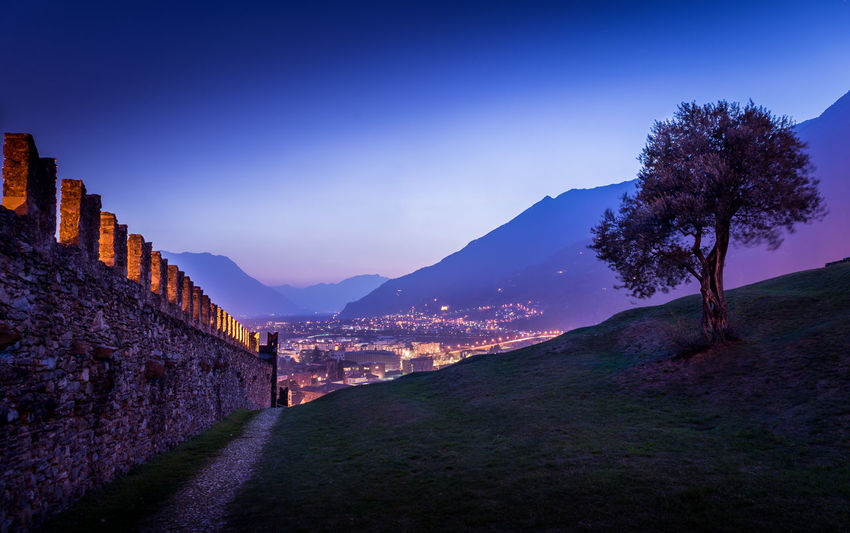 Castle Cities At Night City Life City At Night Cityscape Panorama Path Ruins Beauty In Nature City Lights Colorful Sky Dusk Evening Hill Landscape Lonely Tree No People Outdoors Scenics Spring Sunset Sunset Colors Switzerland Ticino View From Above