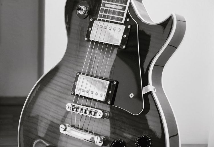 Close-Up Of Electric Guitar At Home