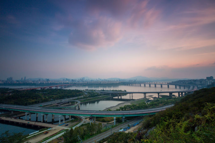 Cityscape of Seoul and Han river at late afternoon. South Korea. Han River Seoul Seoul, Korea Architecture Beauty In Nature Bridge Bridge - Man Made Structure Building Exterior Built Structure City Cityscape Cloud - Sky Connection Day Han River Bridge Nature No People Outdoors River Road Scenics Sky Sunset Transportation Tree Water Mobility In Mega Cities