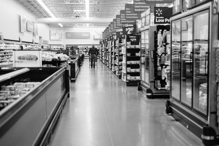 Visual Journal May 2017 Southeast Nebraska A Day In The Life Americans B&w Photography Camera Work Everyday Lives Everyday Nebraska EyeEm Best Shots - Black + White EyeEm Gallery FUJIFILM X100S Grocery Shopping Grocery Store Illuminated Indoors  Photo Diary Photo Essay Practicing Photography Rural America Shopping Storytelling Streetphotography Supermarket Supermarket Vanishing Point Visual Journal Walmart