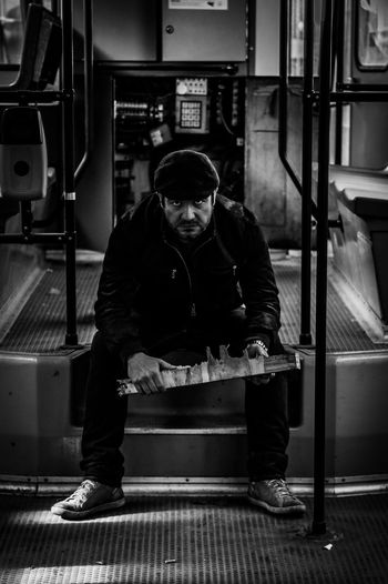 Portrait Of Man Sitting In Abandoned Bus