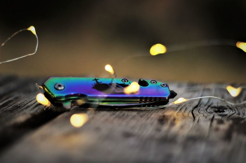 Bokeh Close-up Illuminated Knife Night No People Outdoors Photography Selective Focus Table Texture Wood