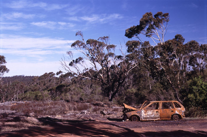 abandoned car in the australian bush Abandoned Australia Australian Blue Burnt Out Car Dirt Gum Gum Trees Nature Outdoors Red Rust Rusty Sky Stolen