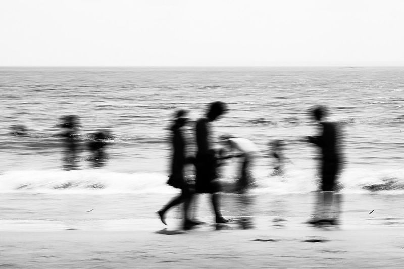 - Unidentifiable Blackandwhite Visual Creativity Storytelling Blackandwhite Photography EyeEm Gallery eyeemphoto Eye4photography  Travcimages EyeEm EyeEm Best Shots Natural Light Sea Sky Water Motion Blurred Motion Horizon Over Water