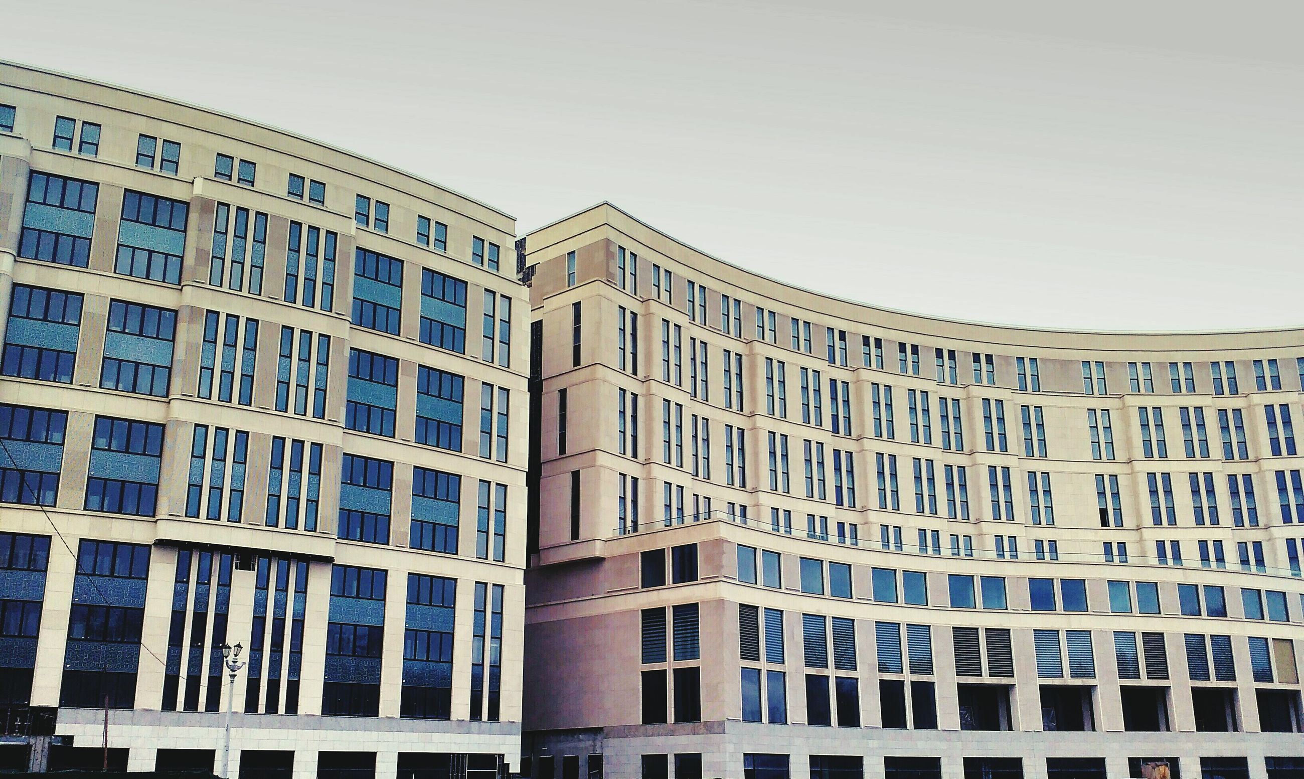architecture, building exterior, built structure, low angle view, window, building, clear sky, city, in a row, repetition, modern, day, glass - material, office building, residential building, pattern, outdoors, no people, residential structure, sky