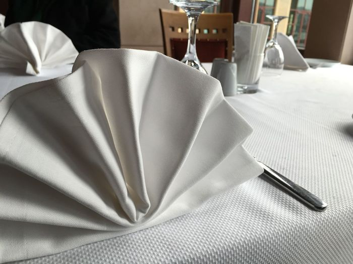Napkins and knife on restaurant table