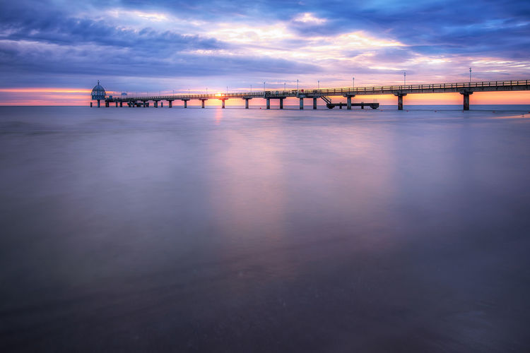 Sunrise over Zinnowitz sea bridge Water Sky Built Structure Architecture Sunset Cloud - Sky Sea Bridge Reflection Connection Scenics - Nature Waterfront Transportation Dusk Nature Tranquility Illuminated Tranquil Scene Outdoors No People EyeEmNewHere Baltic Sea Sunrise Usedom Long Exposure