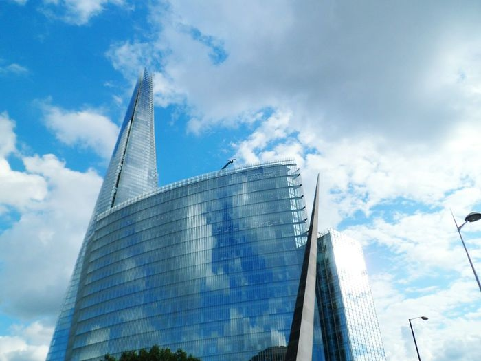 These London buildings appear to be made of clouds Architecture London Reflections Sky Travel Destinations Capital City Travel Capital Cities  International Landmark Blue Sky Tall - High No People Cloud - Sky Famous Place Shard London Bridge Skyscraper Clouds And Sky