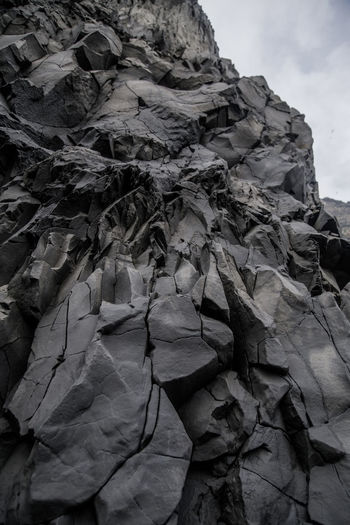 basalt Rock Rock - Object Pattern Rock Formation Rocks Look Up Fissure Cracked Rocks Stone Climbing Desert Rock - Object Sky Cliff Geology Physical Geography Textured  Rugged Rock Face