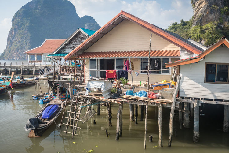 Architecture Water Nautical Vessel Built Structure Building Transportation Building Exterior Day Mode Of Transportation House Nature Mountain Residential District Waterfront Moored Stilt House No People Outdoors Travel Destinations Wooden Post
