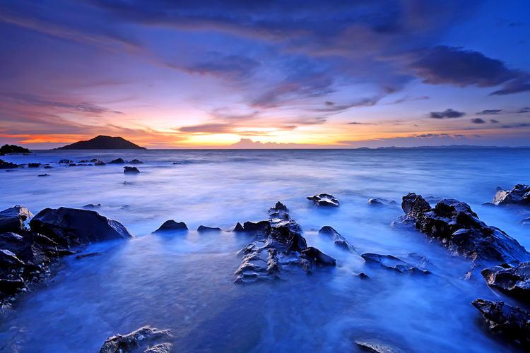 Beautiful sunset on the sea with rocks in foreground, In the eastern part of Thailand Sea Water Scenics - Nature Sky Sunset Beauty In Nature Cloud - Sky Tranquil Scene Horizon Over Water Tranquility Horizon Idyllic Beach Rock Nature Long Exposure Solid Rock - Object Land No People Rayban Heavenly Weather Relaxing Dramatic Sky Dramatic Dramatic Landscape Nature Skyscraper Sky And Clouds Waves Coastline Coastline Landscape ASIA Asian  Travel Thailand