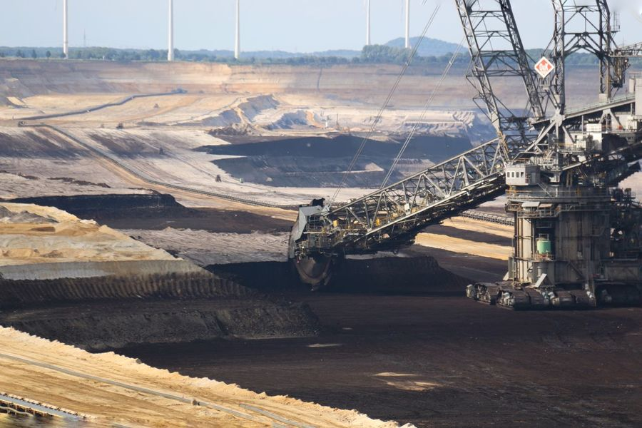 Brown coal surface mining - open cast coal mining. Huge bucket wheel excavator. new developed technology. Supposed to be more environmentally friendly. Bucket Wheel Excavator Engineering No People Open Cast Coal Mining Outdoors Scenics