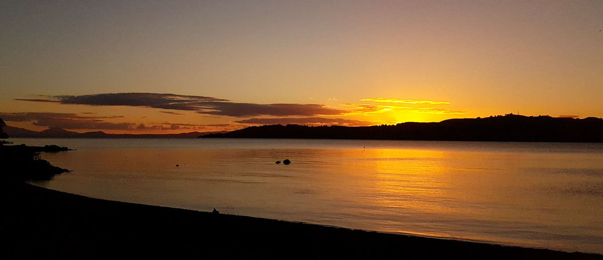 Beauty In Nature Idyllic Lake Taupo Mountain Nature New Zealand No People Orange Color Outdoors Reflection Scenics Sea Silhouette Sky Sunset Taupo Tranquil Scene Tranquility Travel Destinations Water