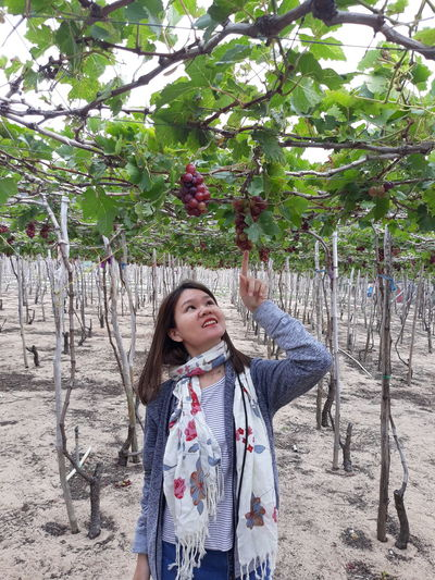 Young Woman Standing At Vineyard