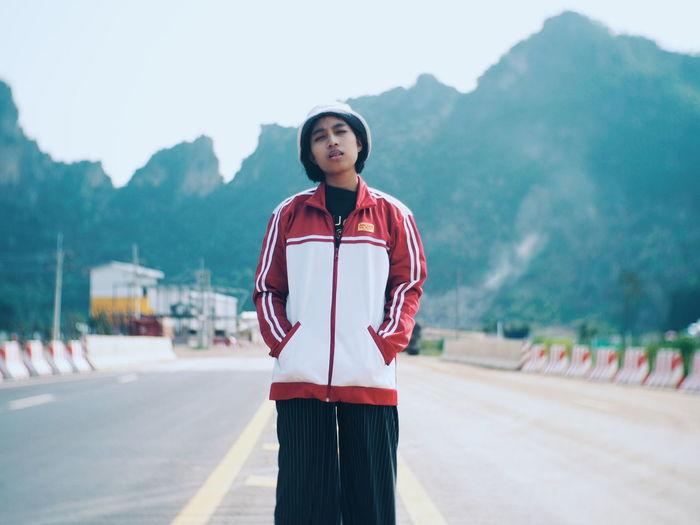 Portrait of teenage girl standing on mountain road