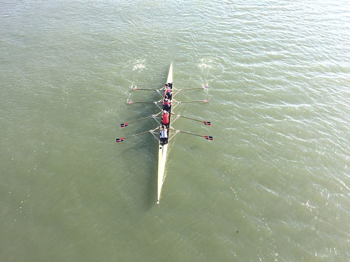 High angle view of people on rowboat in river