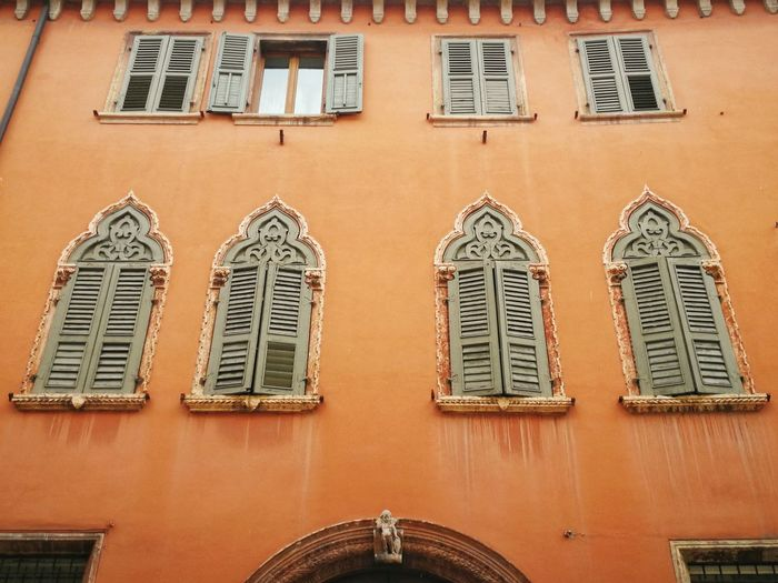 City Detail Deterioration Building Exterior Home House Windows Window Frame Orange Color Verona Veneto Italy Italian Culture Arch Architecture City Window History Architecture Building Exterior Sky Built Structure Close-up Ancient Geometric Shape Triangle The Past Representing Historic Building Historic