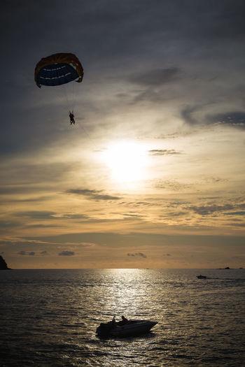 Beach Gliding Glitch Holiday Horizon Over Water Outdoors Parachute Parasailing Sail Sea Seascape Sky Speedboar Sun Sunset Tourism Travel Destinations Vacation Water
