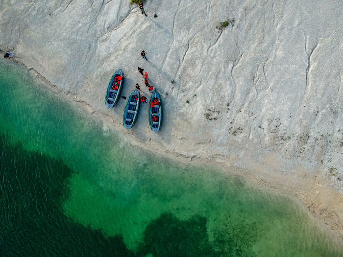 Aerial View Of People By Rafts At Beach