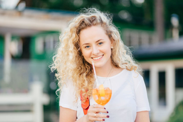 Portrait of smiling woman holding ice cream