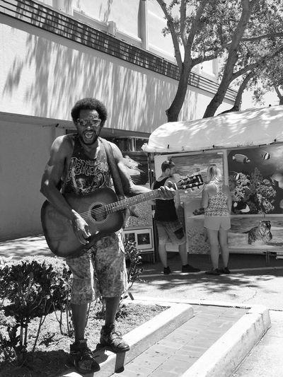 Talented singer at the art festival Guitarist Street Artist Melbourne Florida Art Festival Art Fair Street Musician Heartfelt