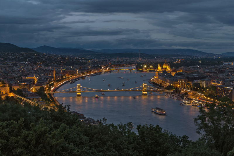 High angle view of illuminated bridge over river against sky