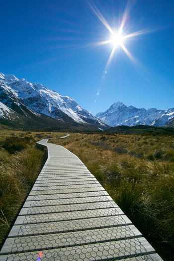 Path to Mount Cook, New Zealand Beauty In Nature Blue Day Idyllic Landscape Lens Flare Mountain Mountain Range Mountains Mt Fuji Nature New York New Zealand Scenery No People Outdoors Scenics Sky Snow Sun Sunbeam Sunlight The Way Forward Tranquil Scene Tranquility Tranquility Live For The Story The Great Outdoors - 2017 EyeEm Awards