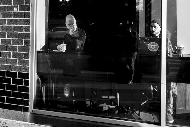Thinking with a coffee New York Streetphotography Streetphoto_bw Street Photography Glass - Material One Person Window Men Transparent Real People Reflection Sitting Food And Drink Adult Occupation Technology Business Communication Lifestyles Store Standing Wireless Technology Working EyeEmNewHere